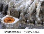 Small photo of White aluminium oxide coats a fanbelt mount while iron oxide discolours an iron screw head