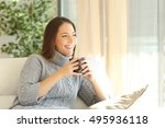 pensive woman wearing a sweater ... | Shutterstock . vector #495936118