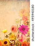 Small photo of Beautiful wild flowers.Textured old paper background. Nature abstract. Vertical image. Can be used both separately and as part of a triptych (composition)