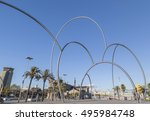 Small photo of BARCELONA,SPAIN-OCTOBER 15,2012: Urban art, sculpture Onades (waves) by artist Andreu Alfaro, Port of Barcelona.