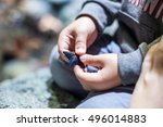 close up on child's hands... | Shutterstock . vector #496014883