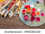 paints  brushes and palette on... | Shutterstock . vector #496038130