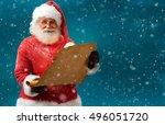 Happy Santa Claus Holding...
