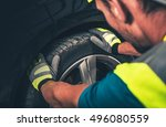 tire and wheel service. men... | Shutterstock . vector #496080559