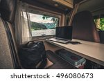 Work and Travel Concept. Laptop Computer on the Motorhome Table. Working While Traveling. Internet Connection. - stock photo