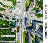 Small photo of Aerial city view with crossroads and roads, houses, buildings, parks and parking lots, bridges. Urban landscape. Copter shot. Panoramic image.