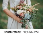 bride in a dress standing in a... | Shutterstock . vector #496233493
