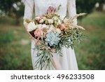 bride in a dress standing in a... | Shutterstock . vector #496233508