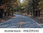 mountain road with fall colors | Shutterstock . vector #496259143