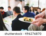 waiter brings a delicious snack ... | Shutterstock . vector #496276870
