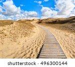 wooden path into the grey dunes.... | Shutterstock . vector #496300144