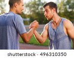 athletic men in workout clothes ... | Shutterstock . vector #496310350
