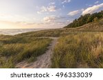 Summer Vacation At The Beach. Winding path through dune grass and sand dunes on the shores of Lake Michigan. Hoffmaster State Park, Michigan.