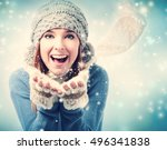 Happy Young Woman Blowing Snow...
