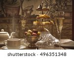 Small photo of luxury afternoon hot tea with champagne and macaroons