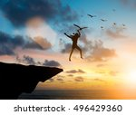 silhouette woman jumps off a... | Shutterstock . vector #496429360