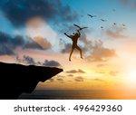silhouette woman jumps off a...   Shutterstock . vector #496429360