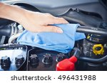 wipe cleaning the car engine... | Shutterstock . vector #496431988