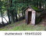 An Outhouse On A Wooded...