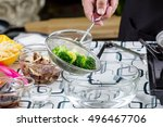 chef boiled broccoli in pot | Shutterstock . vector #496467706