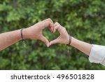 hands in shape of love heart on ... | Shutterstock . vector #496501828