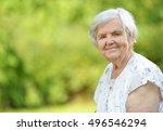 Senior Woman Smiling In Park....
