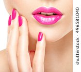 closeup woman hand with pink... | Shutterstock . vector #496581040