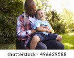 father and son having fun on... | Shutterstock . vector #496639588