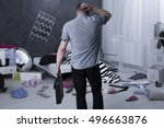 man back view and chaos in... | Shutterstock . vector #496663876
