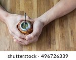 Hands Holding A  Calabash With...