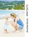 Woman With Toddler On The Beach ...
