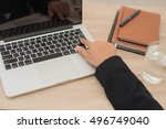 portrait of woman hand typing... | Shutterstock . vector #496749040