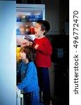 two little boys  secretly... | Shutterstock . vector #496772470