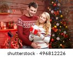 merry christmas. young couple... | Shutterstock . vector #496812226