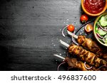 shish kebab of pork and salad.... | Shutterstock . vector #496837600