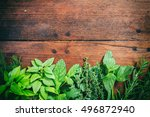 variety of herbs on a wooden... | Shutterstock . vector #496872940