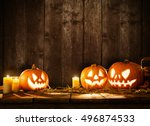 scary halloween pumpkins on... | Shutterstock . vector #496874533