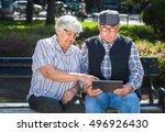 senior couple sitting on a... | Shutterstock . vector #496926430