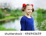 happy schoolgirl in warm cozy... | Shutterstock . vector #496943659