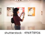 woman visiting art gallery... | Shutterstock . vector #496978936