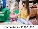 mother and daughter sitting in... | Shutterstock . vector #497031226