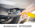 hand holding yellow car towing... | Shutterstock . vector #497032000