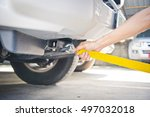 hand holding yellow car towing... | Shutterstock . vector #497032018