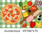 pizza and vegetables on a table.... | Shutterstock .eps vector #497087170