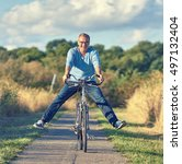 active senior on bike in autumn ... | Shutterstock . vector #497132404