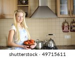 Young housewife posing in kitchen - stock photo