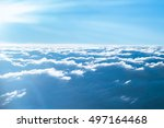 Bright Blue Sky With Clouds An...