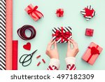 female hands tying a red bow.... | Shutterstock . vector #497182309