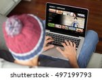 young man surfing on a video on ... | Shutterstock . vector #497199793