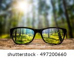 glasses focus background wooden ...